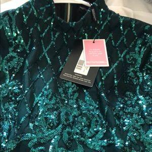 a7ad7520994a PrettyLittleThing Dresses | Emerald Sequins Long Sleeve Tassel Hem ...